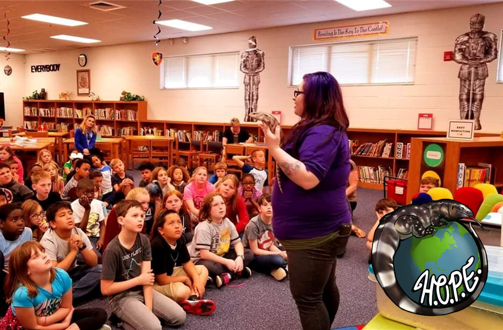 Brittany Carruth educating children about reptiles in a library.